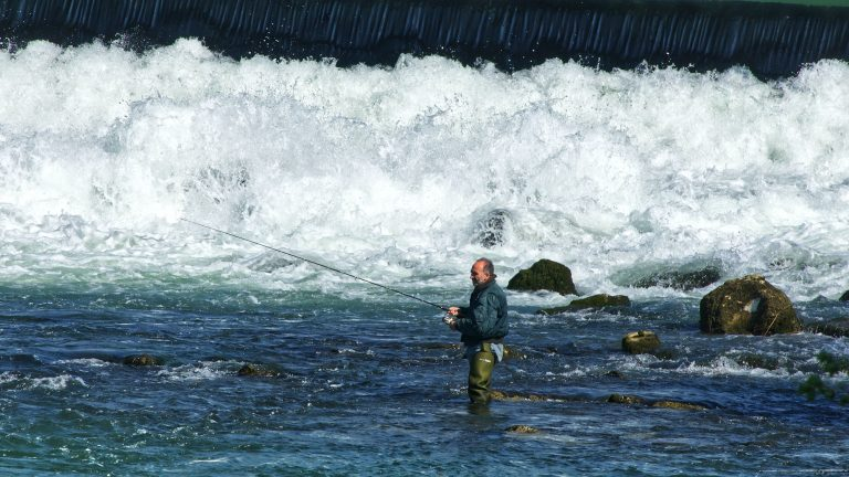man bead fishing