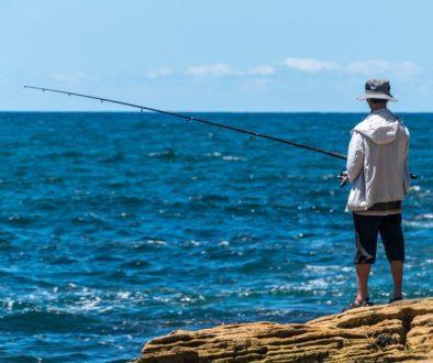 man fishing for black drum