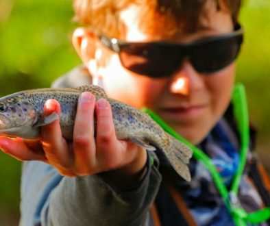 kid fishing for trout