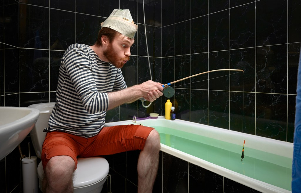 Man catches fish in bath