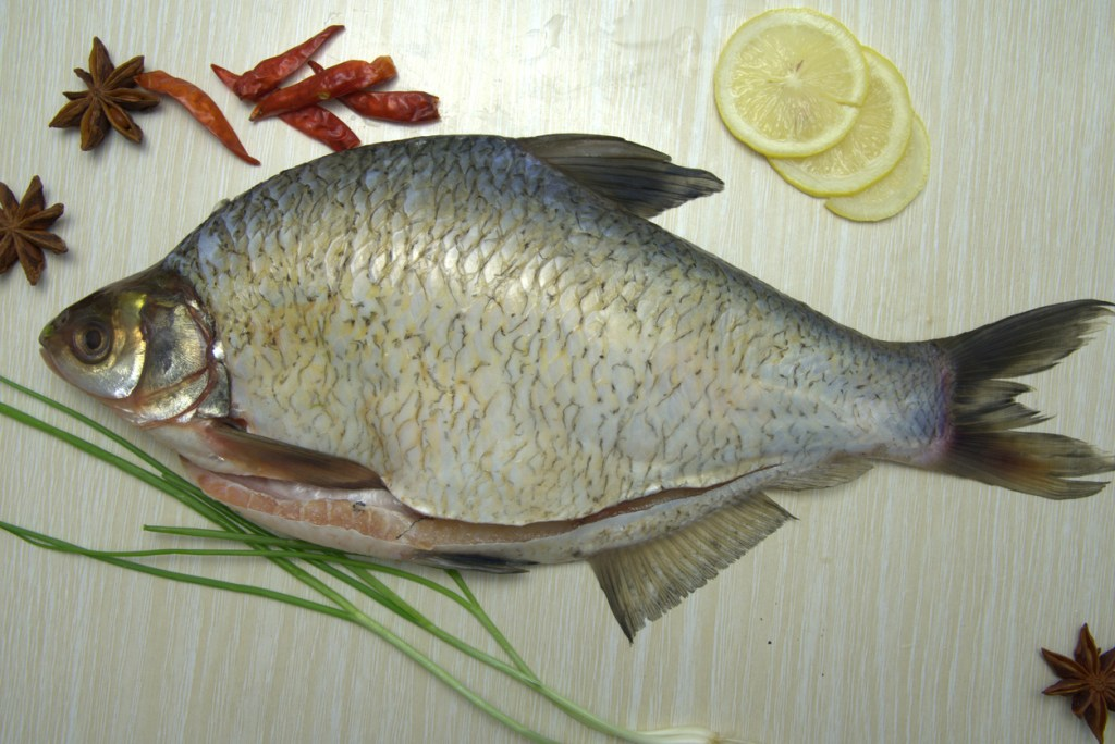 Raw fresh bream with lemon, star anise, chilies and scallions
