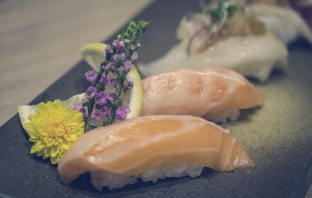 Salmon Sushi on Black Tray