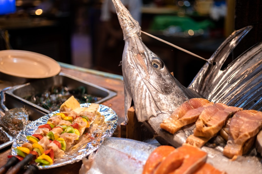 A giant sailfish presented alongwith other seafood for dinner