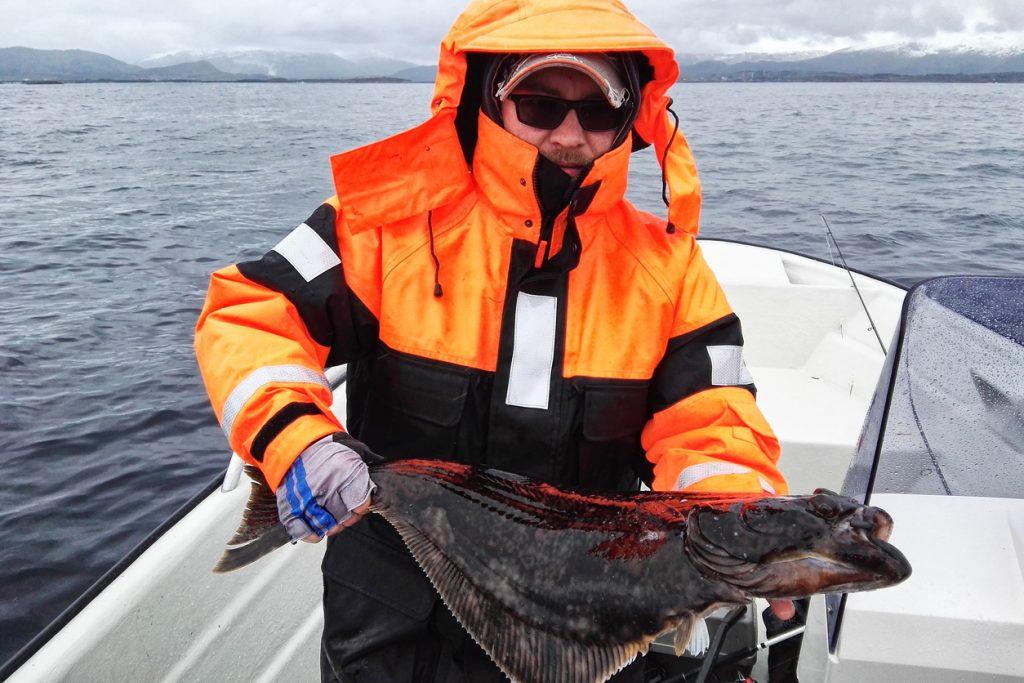 Angler with halibut