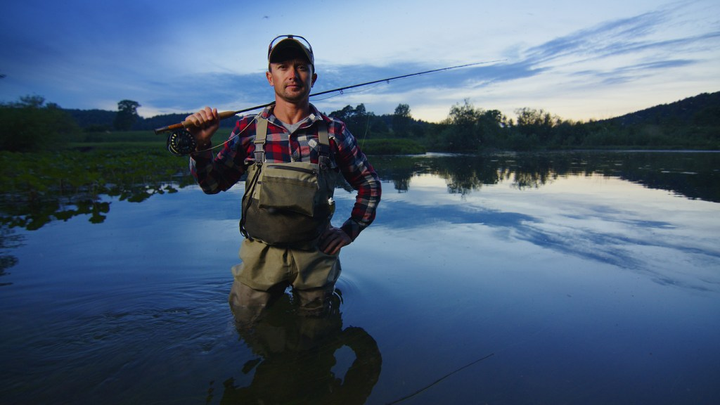 Fly fisherman stands on the river