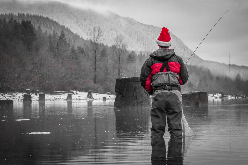 Man Fly Fishing in Santa Hat