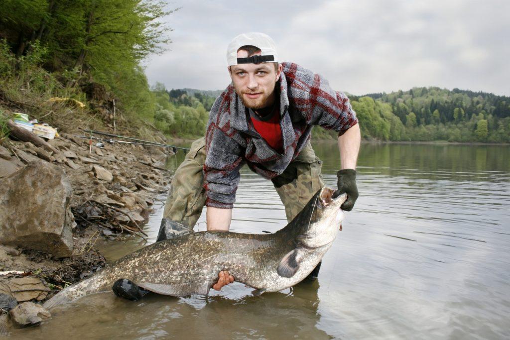 Man holding catfish