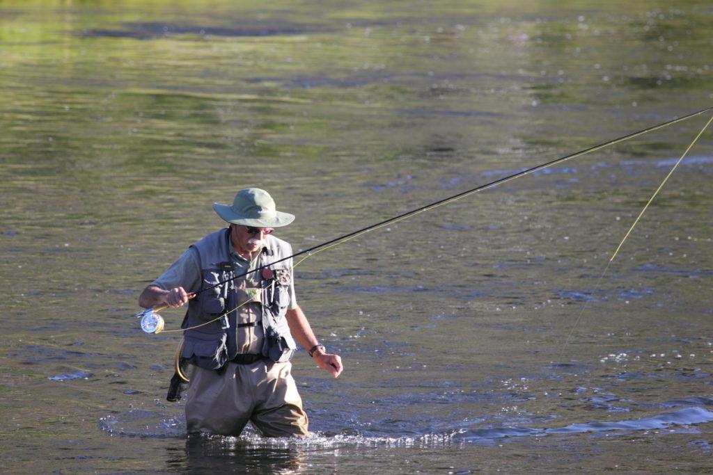 old man fishing in lake